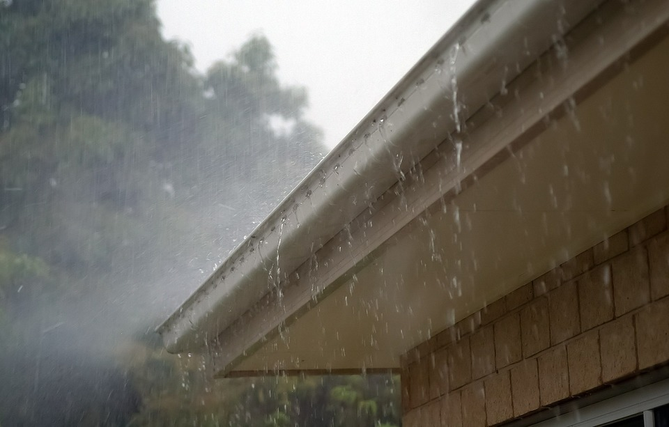 An image of rain falling on a roof.